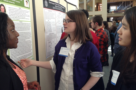 Gloria Appiah-Kubi '13 (from left), talks with Katherine Callaghan '14 and Hyun Jung Chung '13 at the Cornell Undergraduate Research Forum.