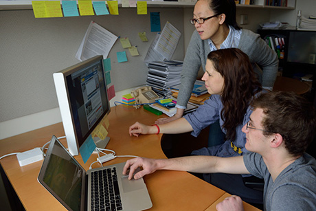 Ying Hua, Assistant Professor in DEA, discussing energy dashboard research with her two student assistants.