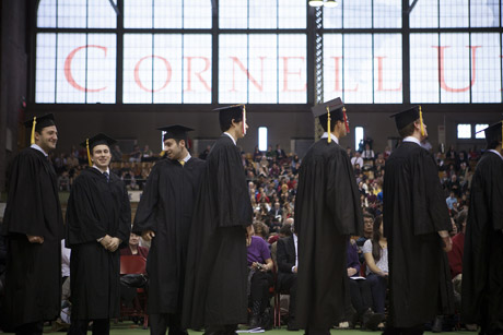 winter graduates process into Barton