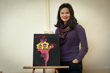 "Meghan Witherow '14 with art she created for the exhibit ""We Step Into the Light Ithaca 2013."""