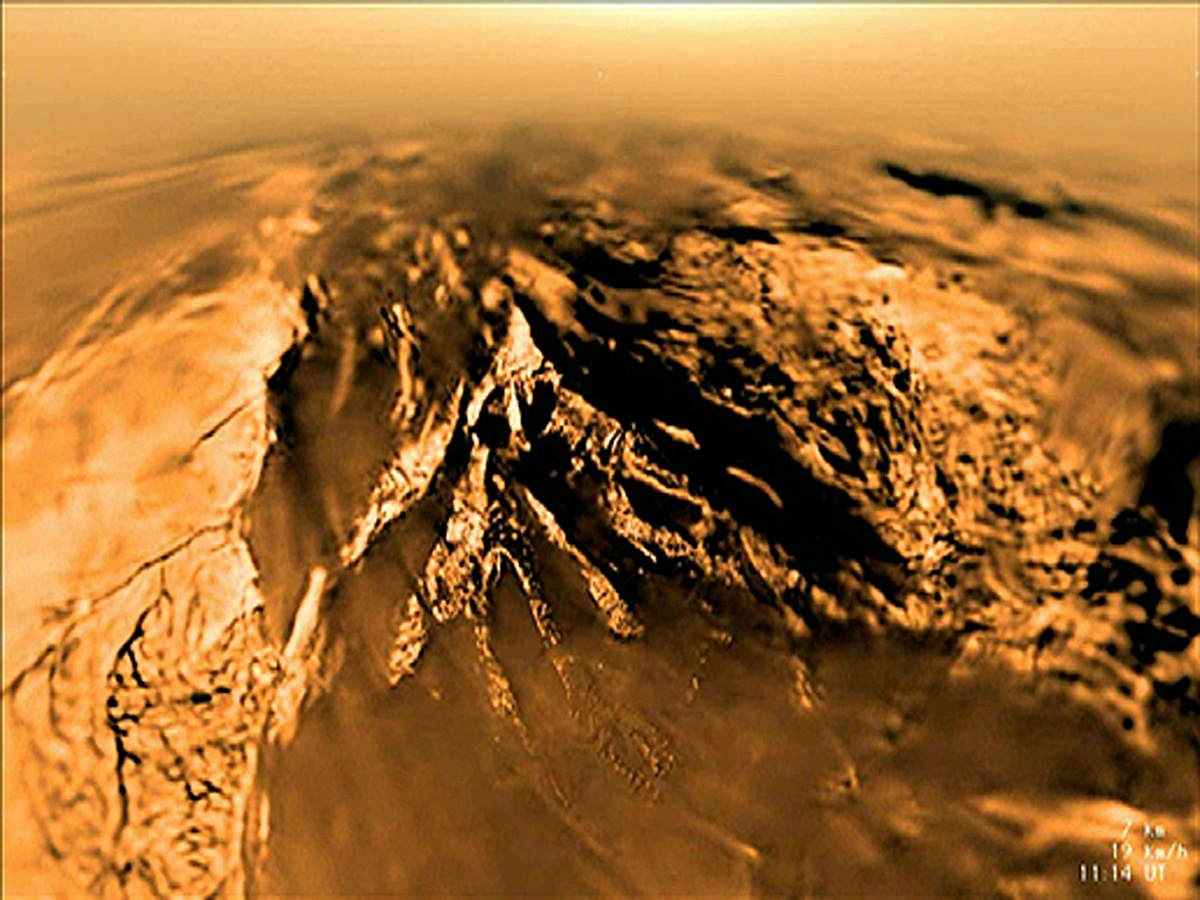 An image of Titan's surface, as taken by the European Space Agency's Huygens probe as it plunged through the moon's thick, orange-brown atmosphere on Jan. 14, 2005. Today, Cornell scientists have chemical evidence that suggests prebiotic conditions may exist there.