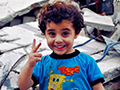 boy in Yarmouk refugee camp