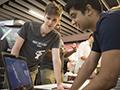 Entrepreneurship students at computer
