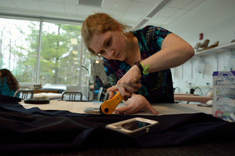 FSAD designer Caroline Delson '13 works with materials for her menswear collection.