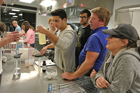 Alex Papazian combines ingredients to create the winning flavor as part of an ice-cream making competition in food science. Photo by Andrea Alfano