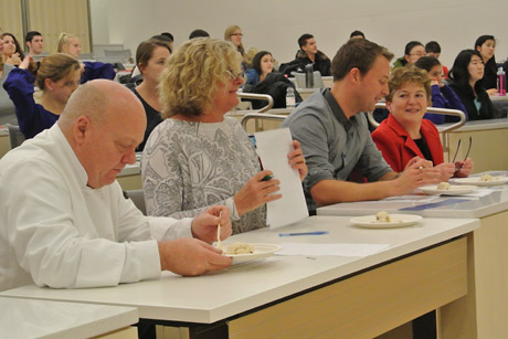 The judging panel for the student ice cream competition includes, from left, Cornell Dining executive chef Steven Miller, extension associate Kimberly Bukowski, assistant professor Robin Dando, and College of Agriculture and Life Sciences Dean Kathryn J. Boor. Photo by Andrea Alfano