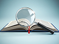 book and magnifying glass