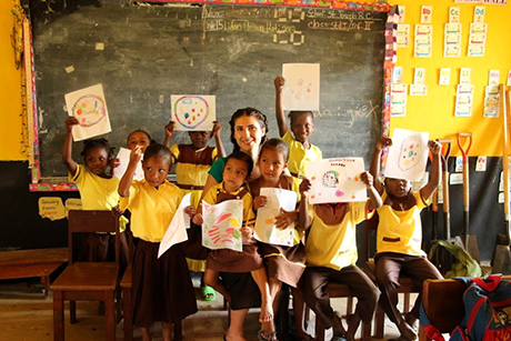 Cornell student with Belize schoolchildren