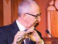 Skorton playing flute