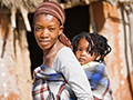Woman carrying child on back