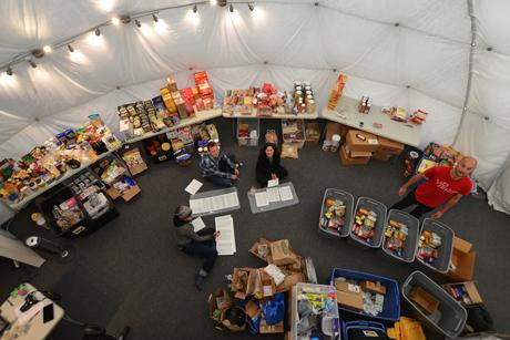 Crew members organize food items