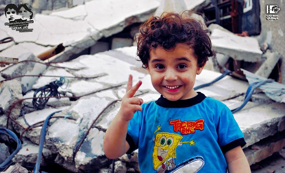 boy in Yarmouk refugee camp